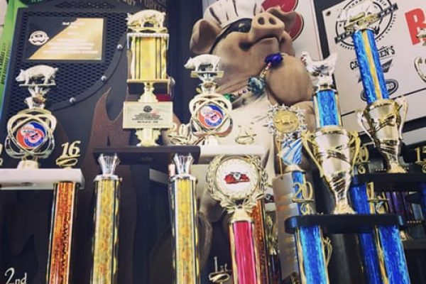 Cackle & Oink Trophies